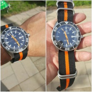 Deep blue t-100 on black/orange nato