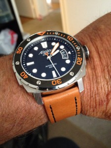 New Strapsco Vintage Style rust with black thread on my Alpina diver Orange. Kicks it up a notch!