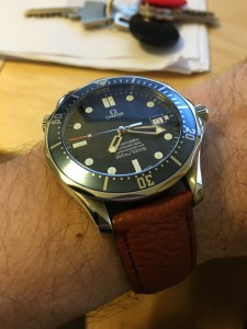 Bond Seamaster with brown leather strap.