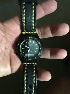 black watch band with yellow stitching