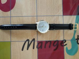 Black leather strap on MVMT watch