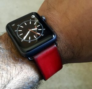 Black Apple Watch Sport with vintage red leather band